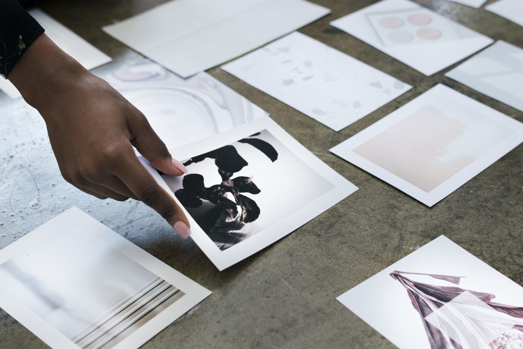 designer laying out images on the floor